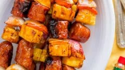 Grilled pineapple sausage skewers that are sweet, spicy, smoky and so flavorful! You won't believe the easy glaze. Easy, excellent brunch skewers recipe. | natashaskitchen.com