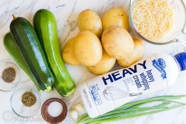 Creamy, cheesy Zucchini Potato Bake in a garlic Alfredo sauce. This potato bake recipe has simple ingredients, comes together quickly and tastes so good! | natashaskitchen.com