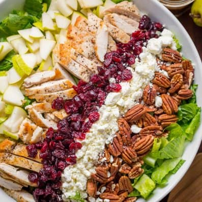 Autumn Chopped Chicken Salad will be your favorite Fall salad. Chicken Salad with pears, craisins, pecans, feta and chicken with easy balsamic vinaigrette! | natashaskitchen.com