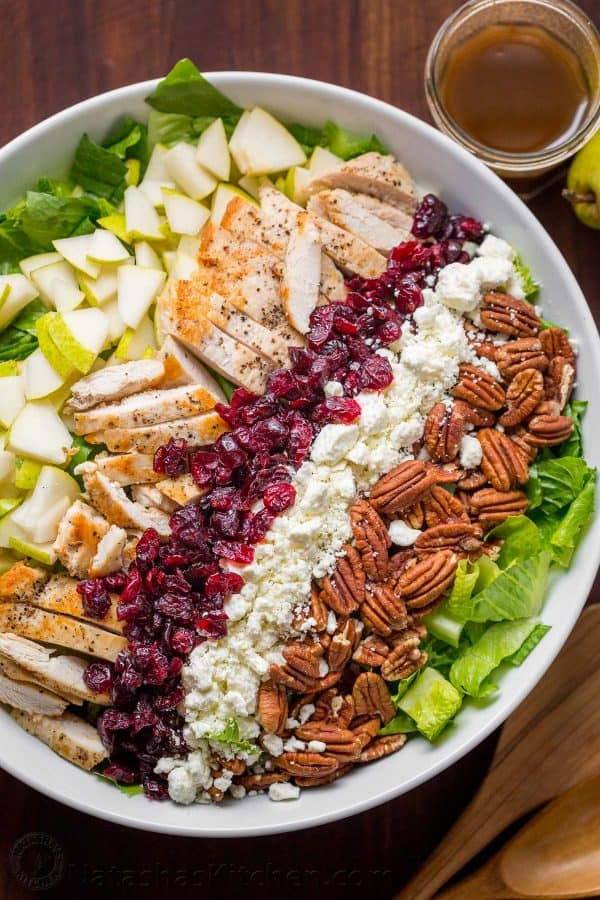 Chopped Chicken Salad Served in strips of chicken, pears, craisins, feta and pecans over a bed or romaine lettuce with balsamic vinaigrette on the side