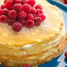 This crepe cake is beautiful and delicious! The fail-proof blender crepes recipe makes this the easiest 30 layer cake you'll make! Best crepe cake frosting! | natashaskitchen.com