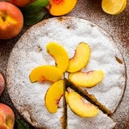 This fresh peach cake recipe is loaded with a pound of sweet summer peaches. Easy peach cake that comes together quickly and is perfect for entertaining! | natashaskitchen.com