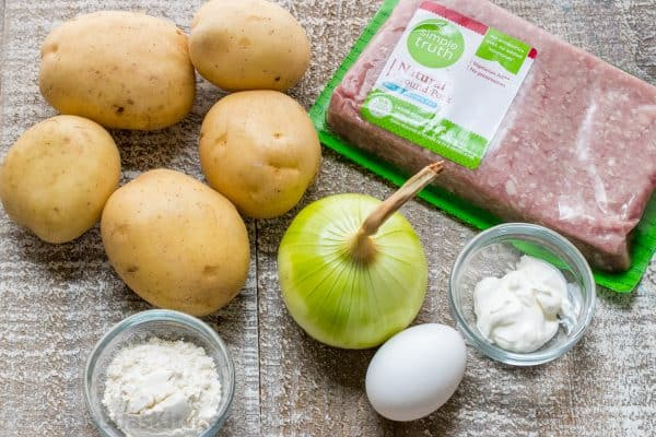 Ingredients for stuffed potato pancakes on the table