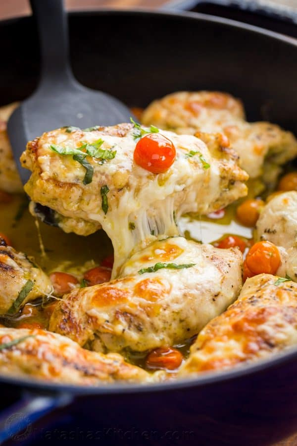 Pesto Chicken Recipe. These Chicken Pesto Roll Ups are stuffed with cheese, juicy tomatoes and pesto!