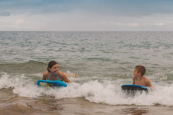 Natasha and her son using a Boogie board in the ocean