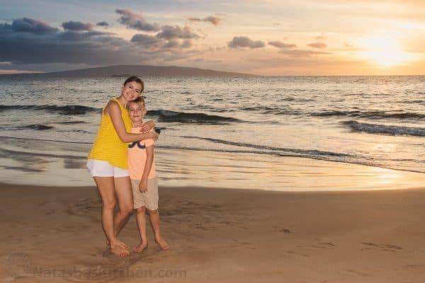 Natasha hugging her son at the beach