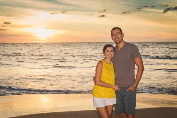 Natasha and her husband smiling at the beach