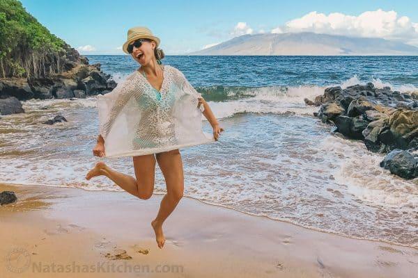 Natasha jumping up by the ocean