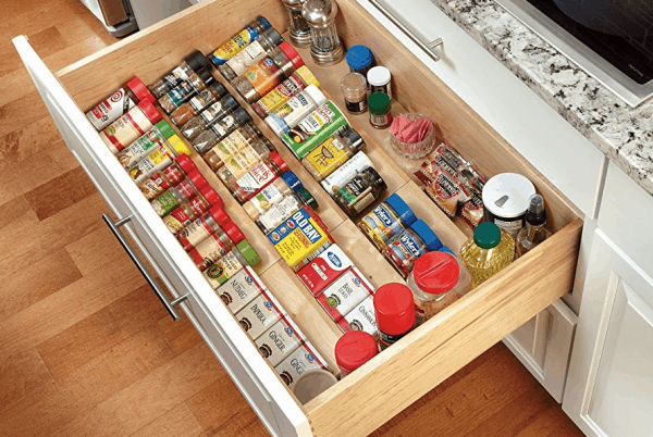 A close up of an organized spice drawer