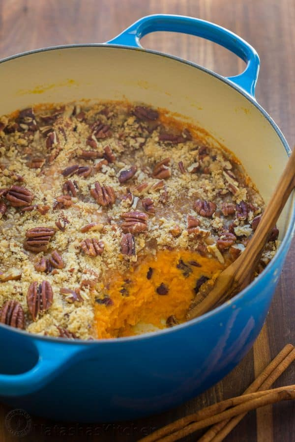 Sweet Potato Casserole with irresistible crunchy pecan topping. Sweet potato casserole is perfect for Thanksgiving! It's smooth and puffs up while baking. | natashaskitchen.com