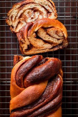Chocolate babka is like a fluffy chocolate cinnamon roll. This babka recipe is laced with chocolate and glazed with ganache which melts into every groove. | natashaskitchen.com