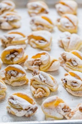 Meringue Shell Cookies have a crisp ribbon of meringue and soft crumbly center. These walnut meringue cookies are completely irresistible Christmas cookies!   natashaskitchen.com