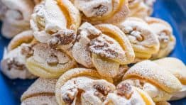 Meringue Shell Cookies have a crisp ribbon of meringue and soft crumbly center. These walnut meringue cookies are completely irresistible Christmas cookies! | natashaskitchen.com