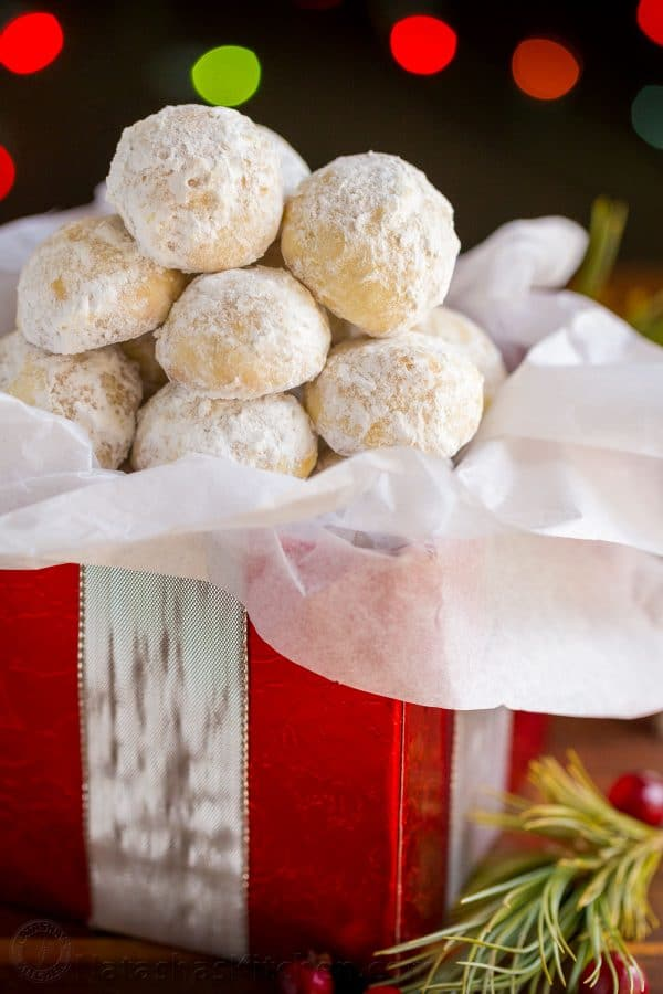 Darling almond snowball cookies that melt in your mouth! Almond Snowball Cookies are perfect for Christmas cookie platters and gifting (make-ahead recipe!) | natashaskitchen.com