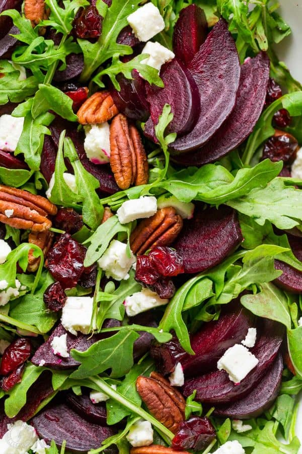 This beet salad recipe tastes fancy but is SO EASY. A show-stopping and flavorful beet salad with arugula with balsamic vinaigrette. It's gluten free, vegetarian and perfect for entertaining. With make-ahead option!