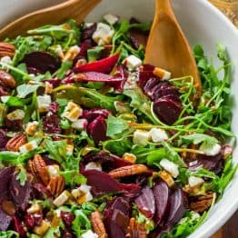 This beet salad recipe tastes fancy but is SO EASY. A show-stopping and flavorful beet salad with arugula with balsamic vinaigrette. It's gluten free, vegetarian and perfect for entertaining. With make-ahead option! | natashaskitchen.com