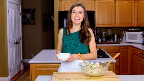 Natasha Kravchuk in a kitchen with a bowl in front of her and one in her hands