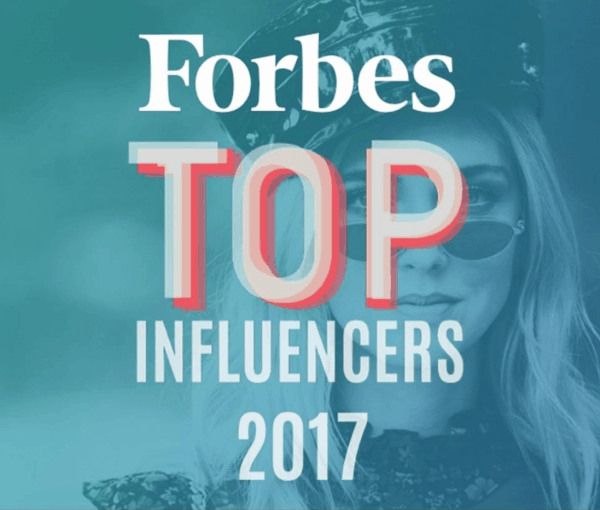A close up of a sign that says Forbes top influencers 2017