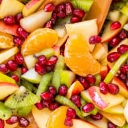 Winter fruit salad is refreshing and loaded with the best fruits of winter. The lemon-lime-honey syrup is lip-smacking good! You'll be running for refills! | natashaskitchen.com