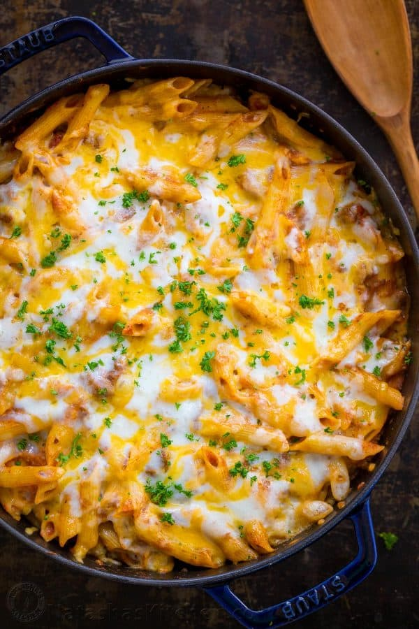 What is a lasagna casserole? This easy lasagna pasta bake has all the same elements of a classic lasagna, but the process is so easy! Everything is combined in a casserole dish (no layering) and this lasagna recipe bakes way faster!