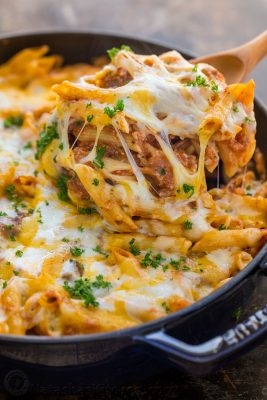 What is a lasagna casserole? This easy lasagna pasta bake has all the same elements of a classic lasagna, but the process is so easy! Everything is combined in a casserole dish (no layering) and this lasagna recipe bakes way faster! | natashaskitchen.com