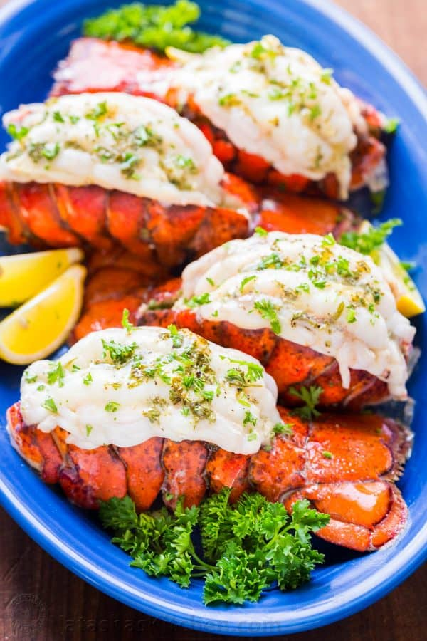 Broiled lobster tails garnished with parsley