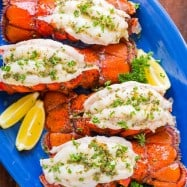 Broiled lobster tails are easier to make than you think. Video tutorial on how to butterfly lobster tails. Broiled lobster meat is crazy tender, juicy and every bite is bursting with fresh lemon butter flavor. | natashaskitchen.com