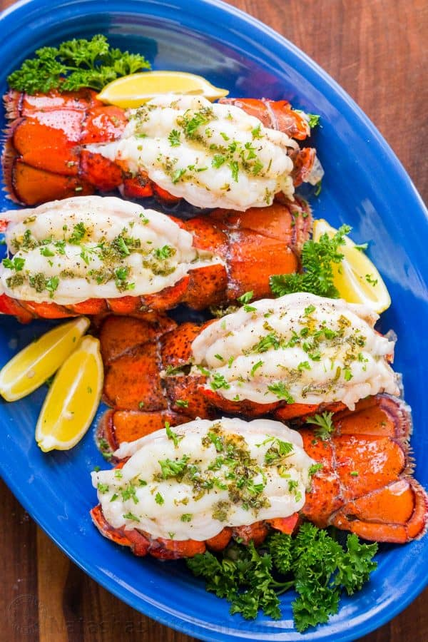 Broiled lobster tails on platter