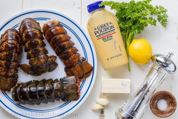 Ingredients for broiled lobster tails with lobster, butter, lemon, garlic, parsley