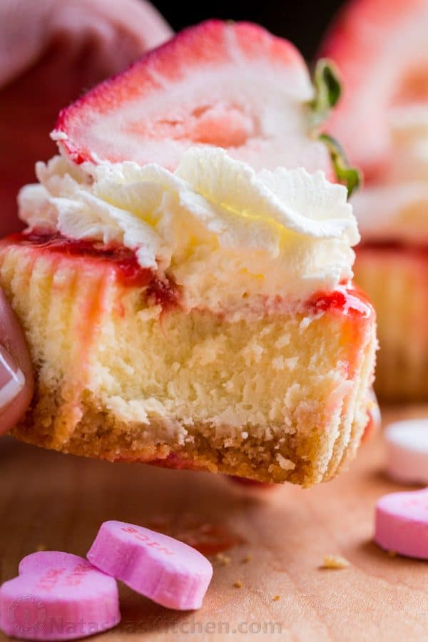 Mini strawberry cheesecakes are easy to make with simple ingredients. The texture in this strawberry cheesecake recipe is is creamy and smooth with a buttery crust. The fresh strawberry topping is irresistible. Valentine's Day Dessert!