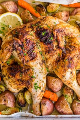 This Spatchcock chicken recipe is our favorite way to roast a whole chicken. Every part of the roasted chicken turns out juicy and so flavorful with that garlic herb butter. Easy and delicious one pan chicken dinner! | natashaskitchen.com