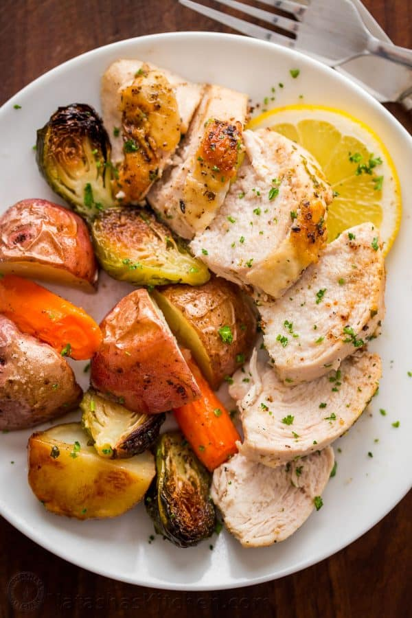 This Spatchcock chicken recipe is our favorite way to roast a whole chicken. Every part of the roasted chicken turns out juicy and so flavorful with that garlic herb butter. Easy and delicious one pan chicken dinner!