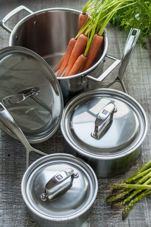 Zwilling J.A. Henckels cookware one pot with carrots and next to the cookware is asparagus