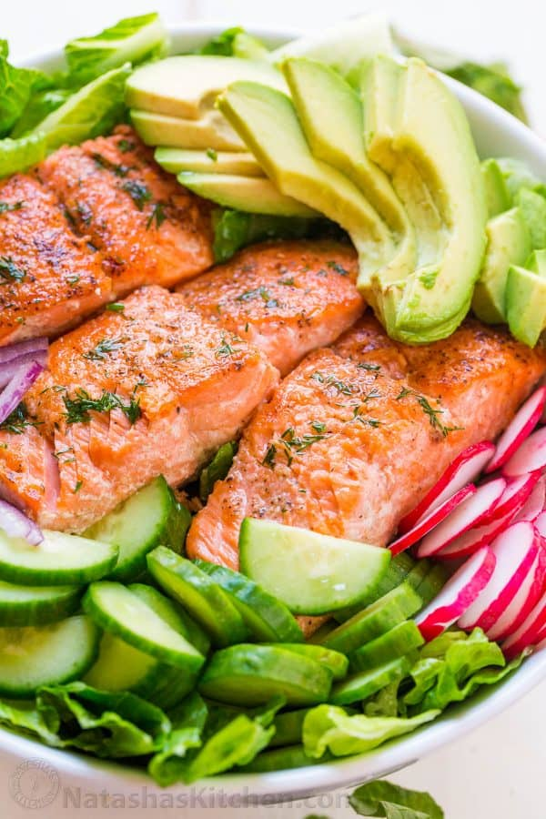 This avocado salmon salad recipe is loaded with all of the best salad ingredients; crisp cucumber and lettuce, and juicy pan seared salmon. The lemon dill dressing is so easy and gives this salmon salad amazing fresh flavor.
