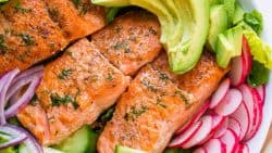 This avocado salmon salad recipe is loaded with all of the best salad ingredients; crisp cucumber and lettuce, and juicy pan seared salmon. The lemon dill dressing is so easy and gives this salmon salad amazing fresh flavor. | natashaskitchen.com