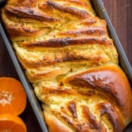 This Braided Easter Bread has the softest crumb. It is laced with farmer cheese and studded with apricots and orange zest which gives the entire loaf amazing flavor and aroma. Make this Easter Bread your new Easter tradition. This brings a cheese Paska and Classic Kulich together into 1 impressive Easter bread! | natashaskitchen.com