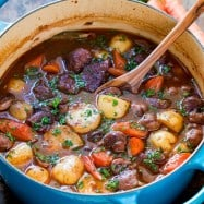 Classic lamb stew is loaded with hearty, healthy ingredients. This lamb stew recipe is simple (a one-pot meal!) and perfect for special occasions (think Easter!). Baking the stew in the oven makes the tender lamb morsels and root vegetables just melt in your mouth. Learn how to make traditional lamb stew. | natashaskitchen.com