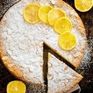 Almond cake recipe with lemon and a slice removed