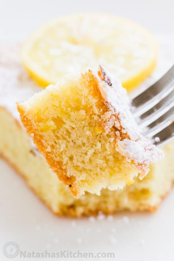 Piece of cake on a fork showing texture of soft almond flour cake