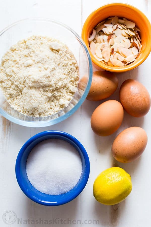 Ingredients for almond flour cake with almond flour, sliced almonds, eggs, sugar and lemon zest