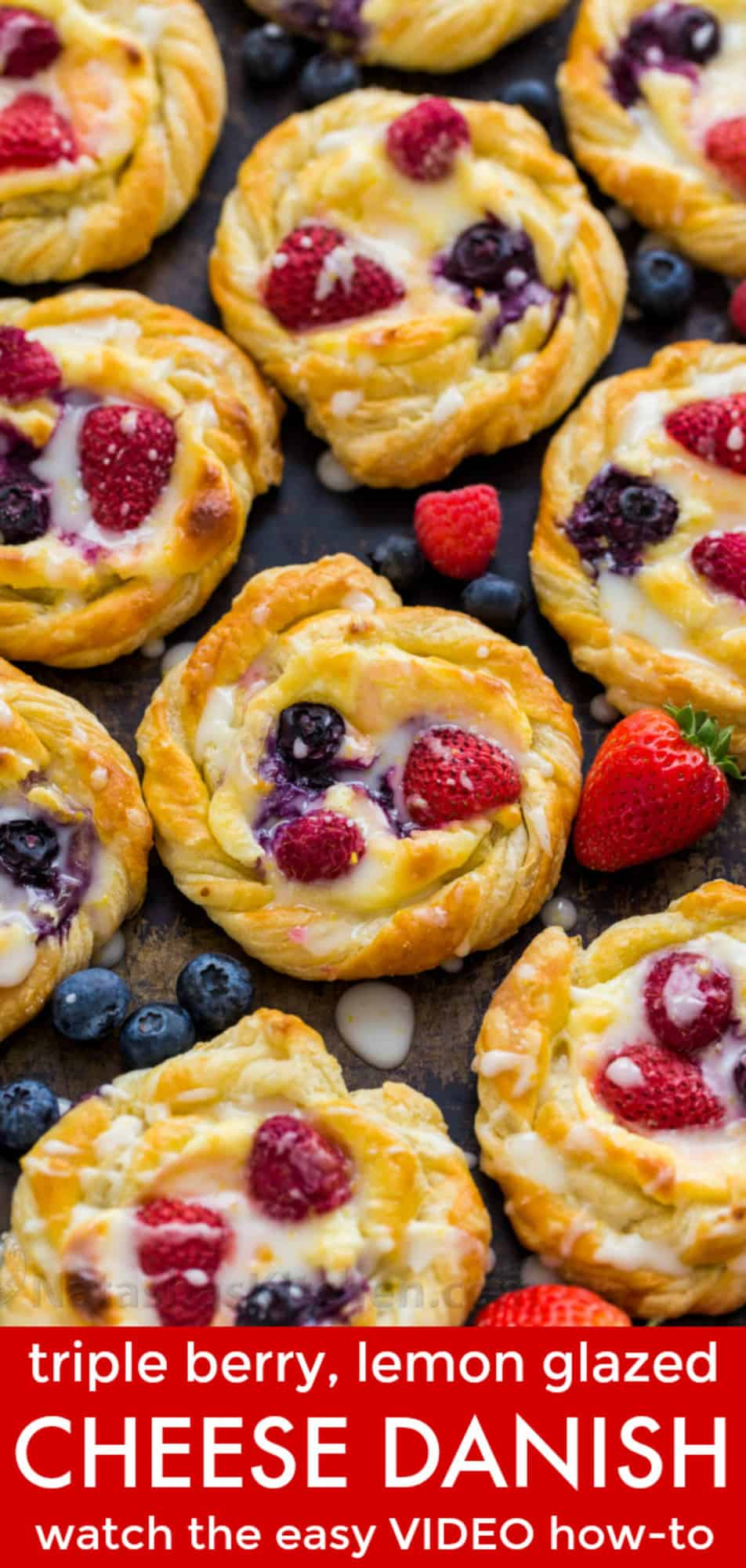 Cheese danish puff pastry recipe served with a drizzle of lemon glaze surrounded by berries