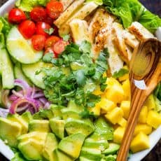 Chicken Mango Avocado Salad recipe in a bowl served like Cheesecake Factory recipe (copycat).