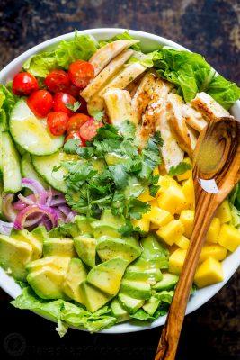 Chicken Mango Avocado Salad recipe in a bowl served like Cheesecake Factory recipe (copycat).
