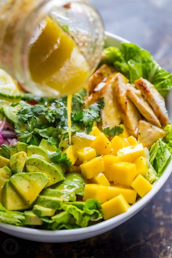 19066178cf honey vinaigrette dressing pouring over chicken mango salad with same  flavor profile as cheesecake factory recipe