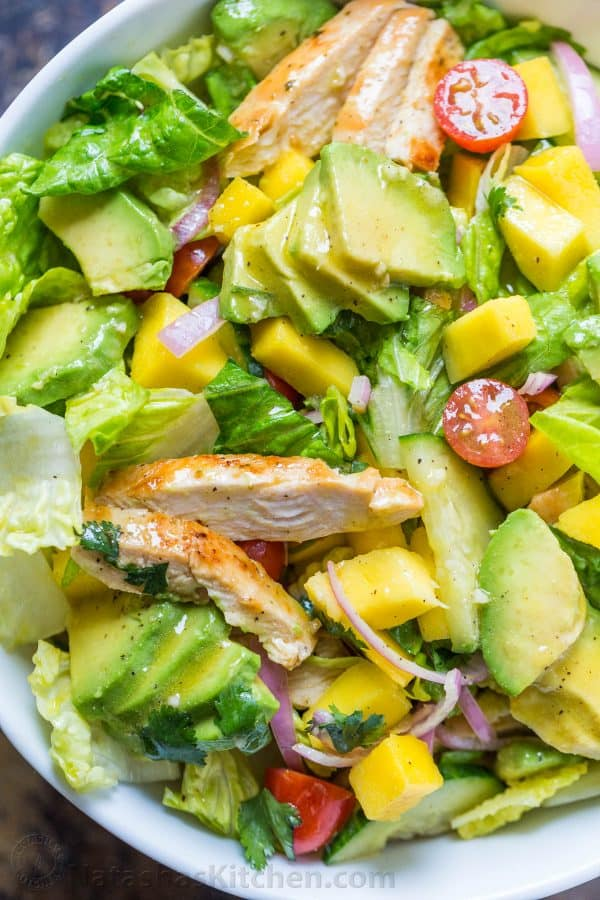 06b86424aa Tossed chicken mango avocado salad with honey vinaigrette with mango,  seared chicken and sliced avocado