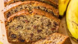Sliced moist banana nut bread with overripe bananas