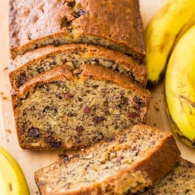 Sliced moist banana nut bread with overripe bananas