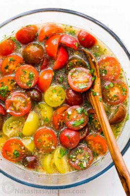 Marinated cherry tomatoes are a colorful, juicy and tasty side dish that is perfect for summer parties, buffets and large gatherings because it can be made hours in advance. This is one of our favorite cherry tomato recipes! Italian marinated tomatoes with just 4 ingredients! | natashaskitchen.com