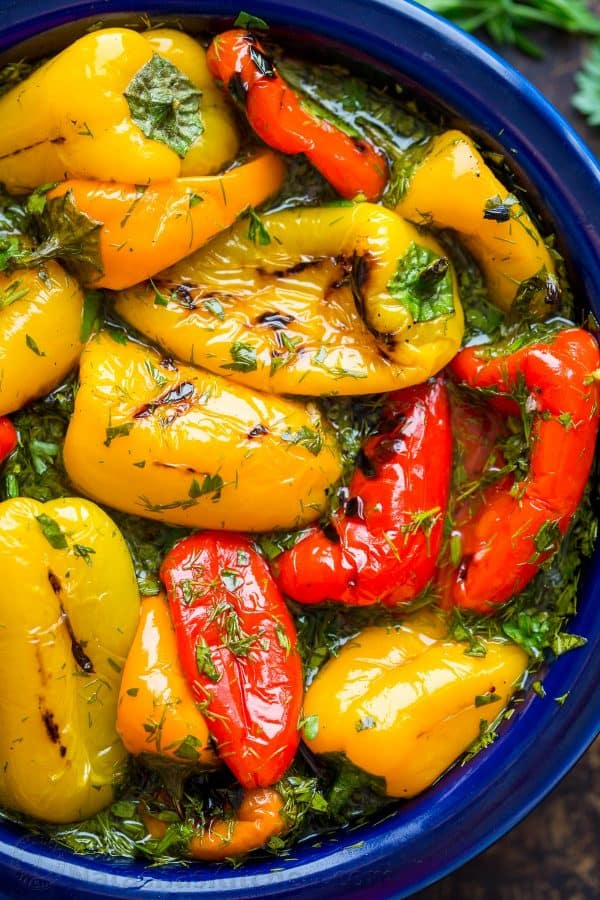 Bell pepper recipe with marinated mini sweet peppers in bowl with herbs