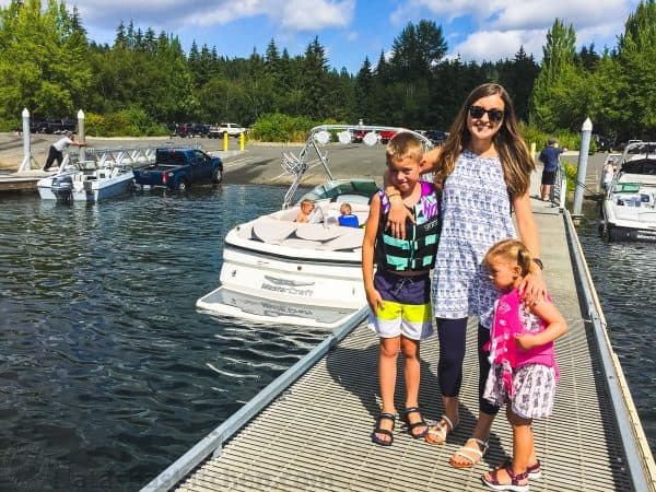 Natasha with children on dock with boat in background